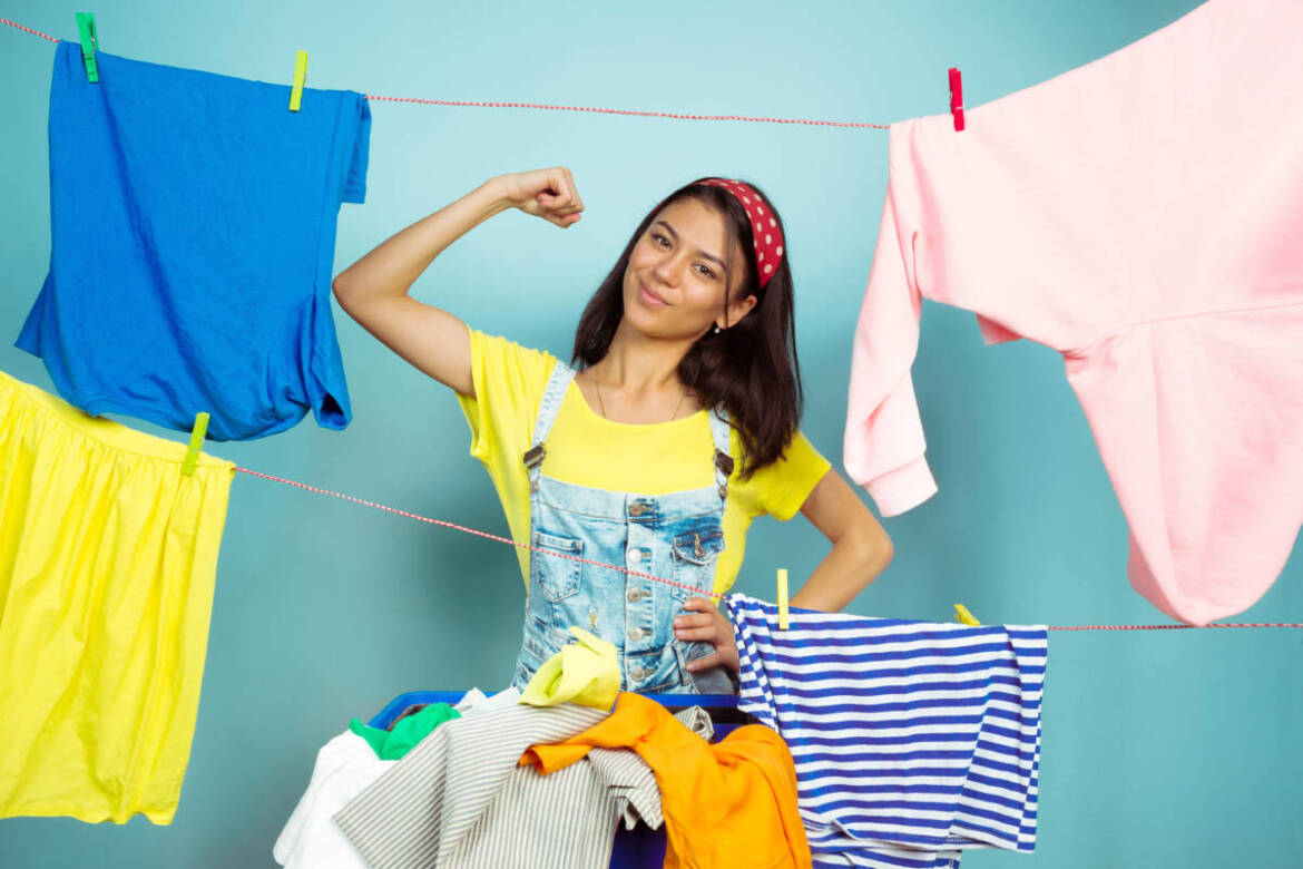 funny-beautiful-housewife-doing-housework-isolated-blue-background-young-caucasian-woman-surrounded-by-washed-clothes-domestic-life-bright-artwork-housekeeping-concept-posing-like-hero-scaled.jpg